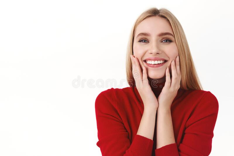 Beauty, women and fashion concept. Close-up portrait of attractive, feminine blond caucasian woman in stylish turtleneck royalty free stock image