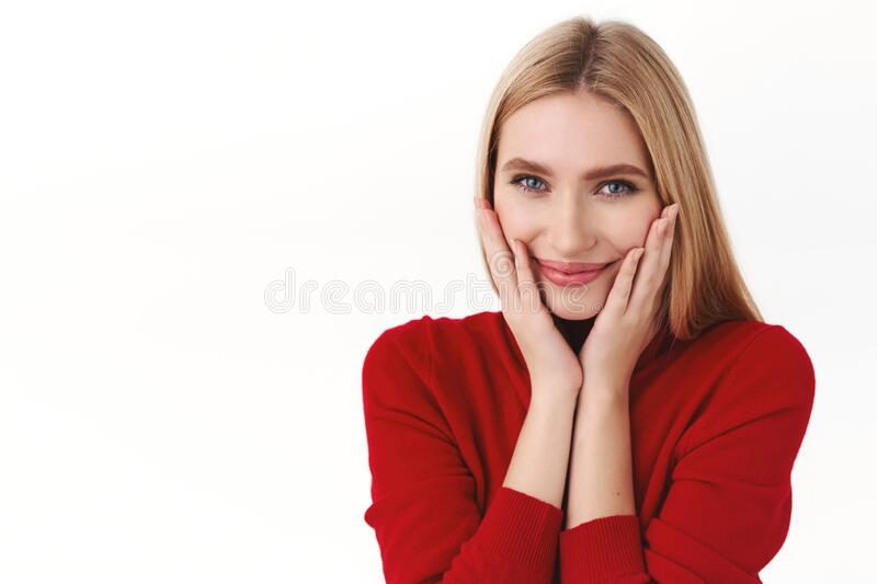 Beauty, women and fashion concept. Close-up portrait of romantic, dreamy attractive woman in stylish red turtleneck stock photography