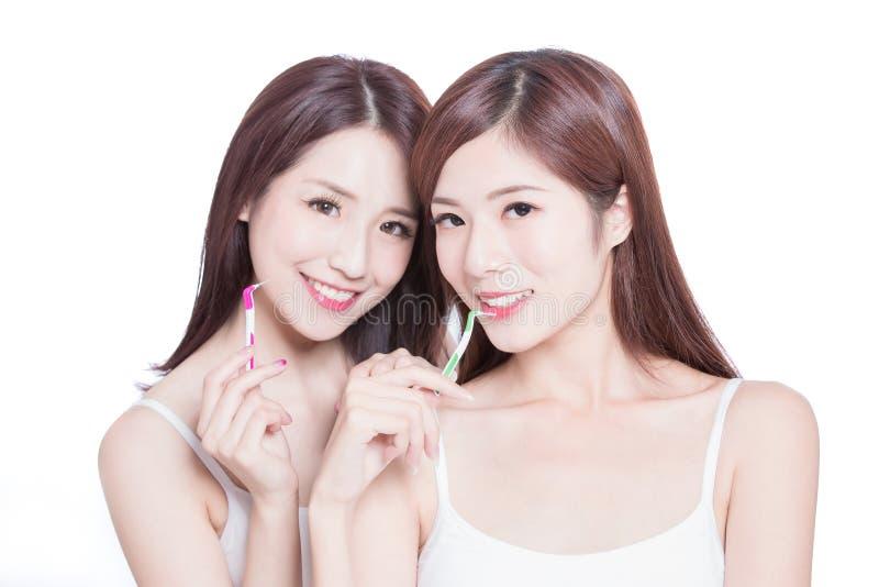 Beauty women take interdental brush royalty free stock images