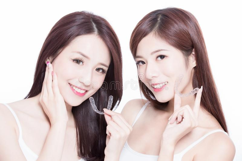 Beauty women take invisible braces stock image