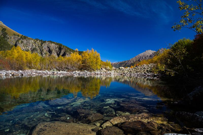 Beauty world. Fantastic sunny day is in mountain lake. royalty free stock image