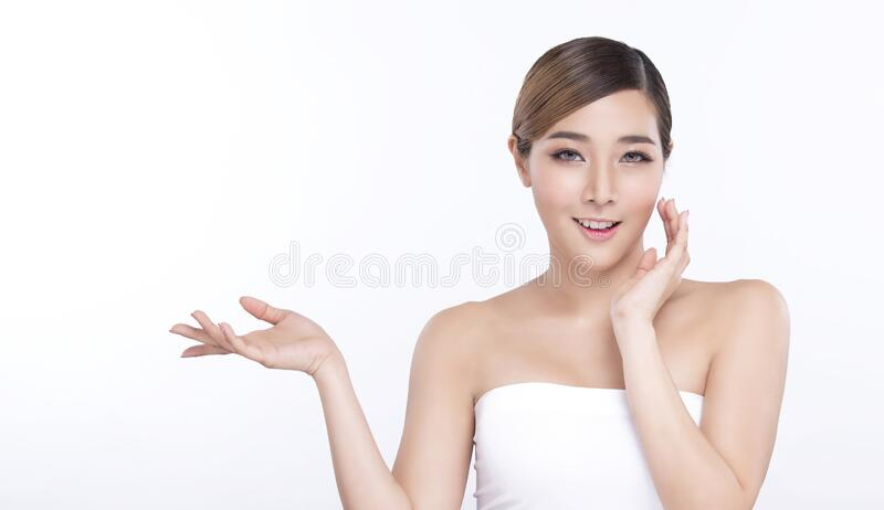 Beauty young asian woman hand showing for product on white background. treatment & Skin care concept stock photo