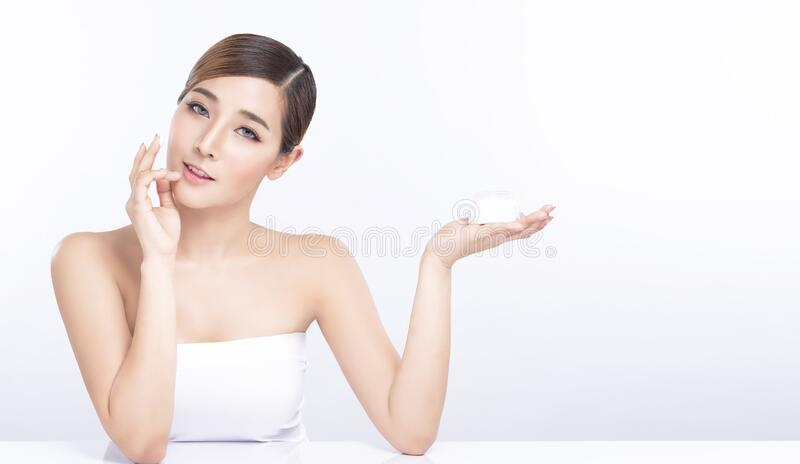 Beauty young asian woman hand showing for product on white background. treatment & Skin care concept royalty free stock photo