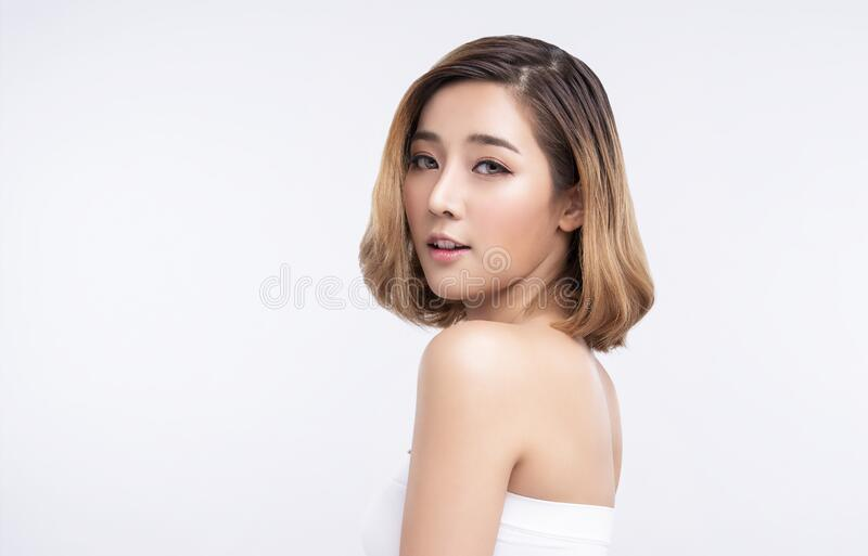 Beauty Young asian woman with perfect facial skin. Gestures for advertisement treatment spa and cosmetology stock photos