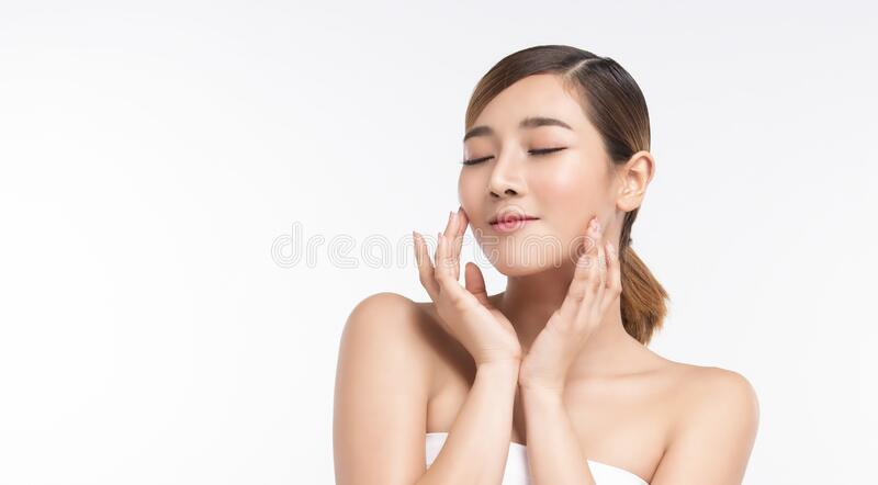 Beauty Young asian woman with perfect facial skin. Gestures for advertisement treatment spa and cosmetology stock photography