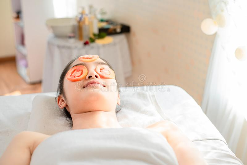 Beauty young asian woman relax and lying on massage bed in spa salon.Traditional thai oriental aromatherapy and Massage beauty stock image