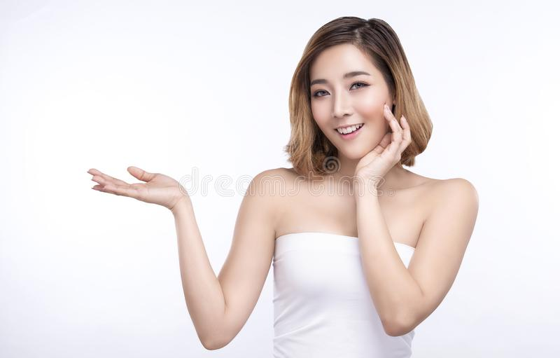 Beauty young asian woman showing hand for product on white background. treatment & Skin care concept royalty free stock photos