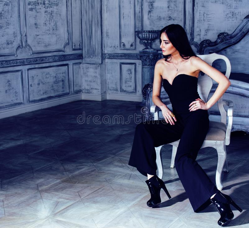 beauty young brunette woman in luxury home interior, fairy bedro royalty free stock photography
