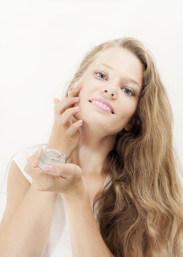Beauty young girl applying gel royalty free stock photo