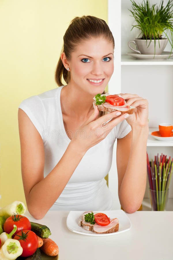 Beauty, young girl eating sandwich royalty free stock photo
