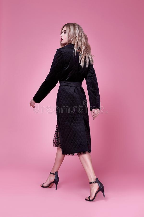 Beauty young elegant woman pretty beautiful face makeup blo. Nd hair style wear black coat fashion clothes stylish model glamour accessory high heels shoes pink royalty free stock photos