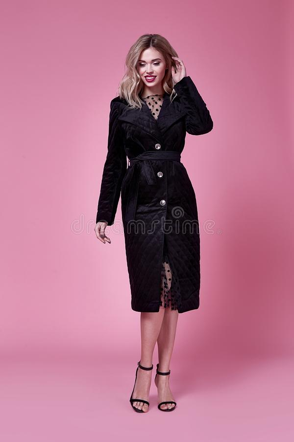 Beauty young elegant woman pretty beautiful face makeup blo. Nd hair style wear black coat fashion clothes stylish model glamour accessory high heels shoes pink stock images