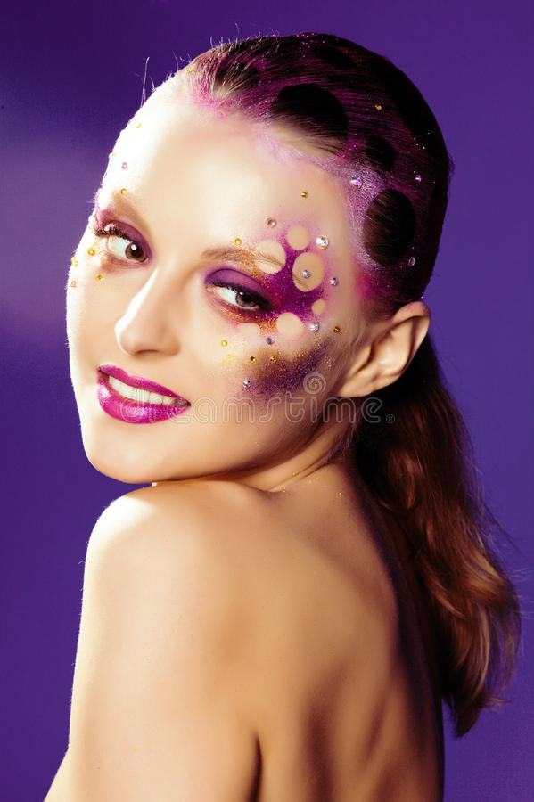 Beauty young woman with creative make up, mystery tinsel. Beauty young woman with creative conceptual make up, mystery tinsel stock photography