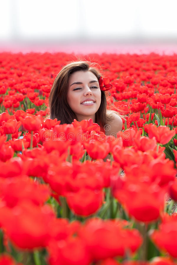 Download Beauty Young Woman With Flowers Tulips Stock Image - Image: 30931317