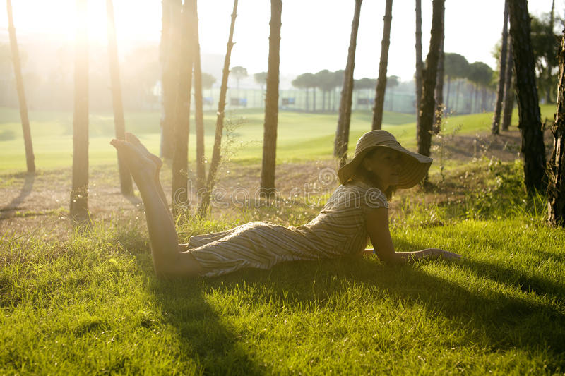 Beauty Young Woman On Golf Fiel Relaxing Royalty Free Stock Photography