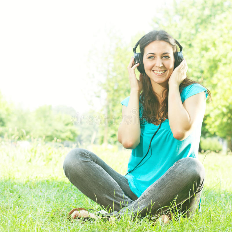 Beauty young woman with headphones stock photo