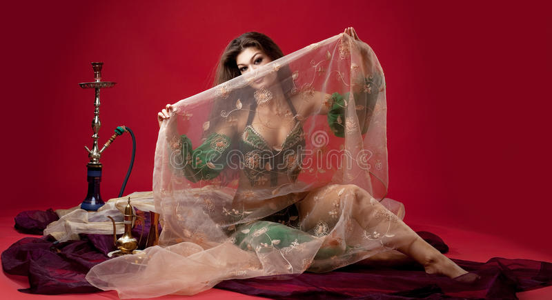 Beauty young woman with hookah on veil royalty free stock photo