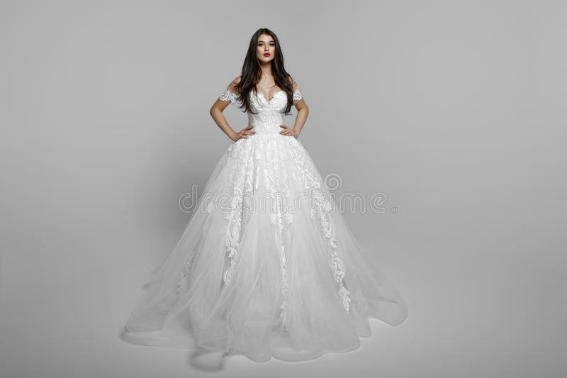 Luxury bride in long white wedding princess dress. Charming bride in a magnificent wedding dress. royalty free stock photos