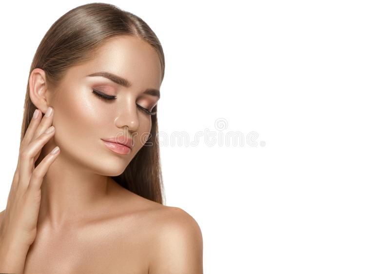 Beauty young Woman with perfect fresh skin Portrait. Beautiful Spa Girl on white background. Perfect Make-up. Cleansing royalty free stock image