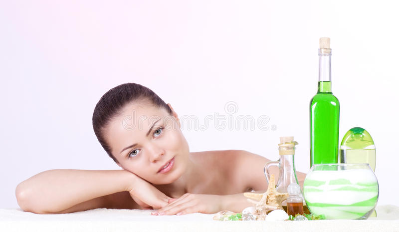 Beauty young woman with spa oils stock photography