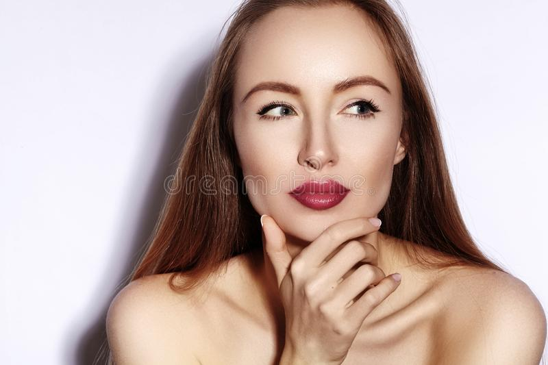 Beauty young Woman on white. Beautiful Model Girl with Makeup, Red Lips, Perfect Fresh Skin. Flirting Expressive Face royalty free stock image