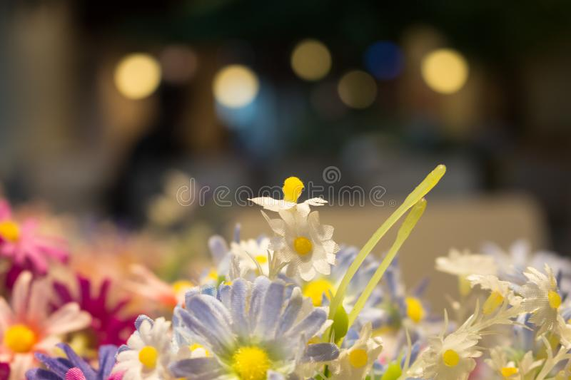 the beautyful artificial flowers on light blurred bokeh background stock image