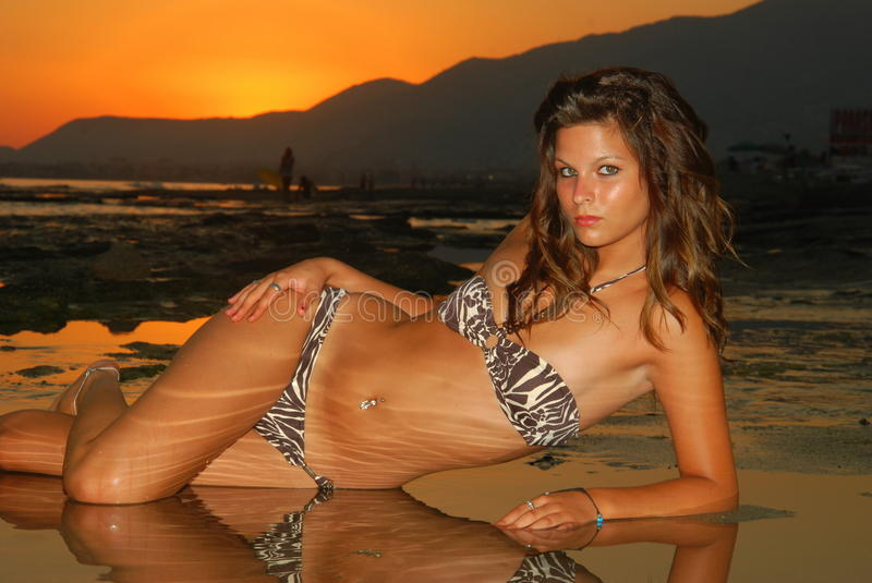 Beautyful, attractive young woman at the beach royalty free stock photo