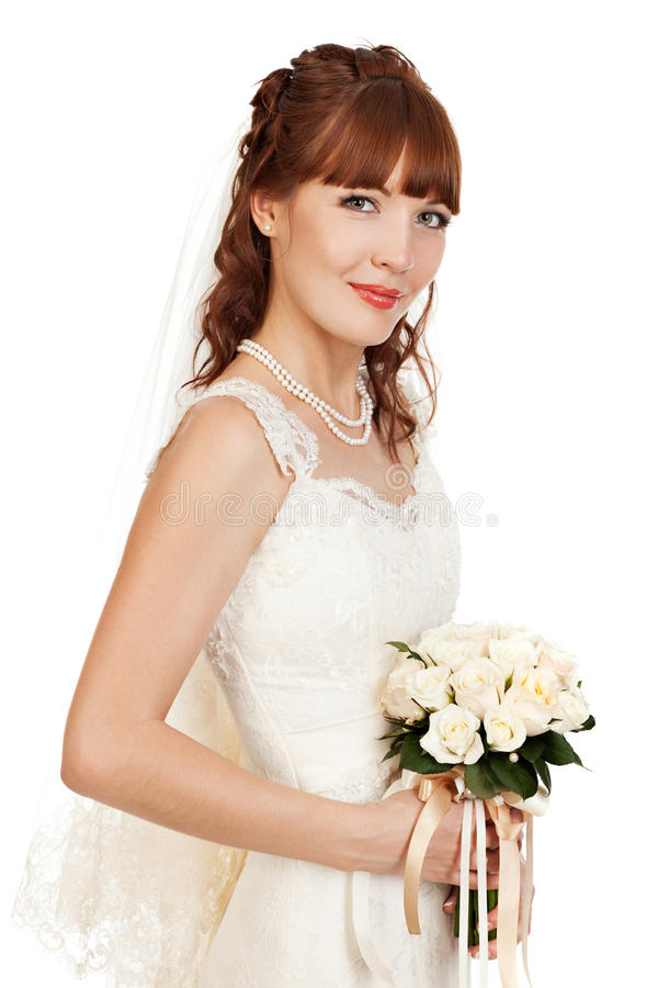 Download A Beautyful Bride Holding Her Bouquet From Roses And Smiling.  I Stock Image - Image: 36755641