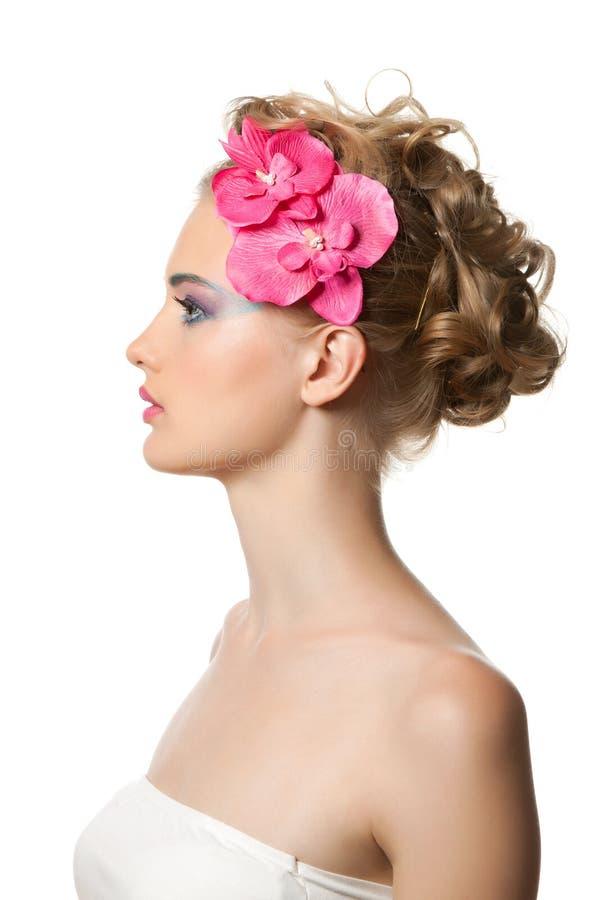 Beautyful Frau mit Blume lizenzfreies stockbild