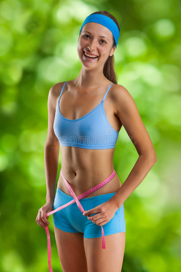 Download Beautyful Smiling Girl With Measure Tape Stock Photo - Image of alone, body: 26761878
