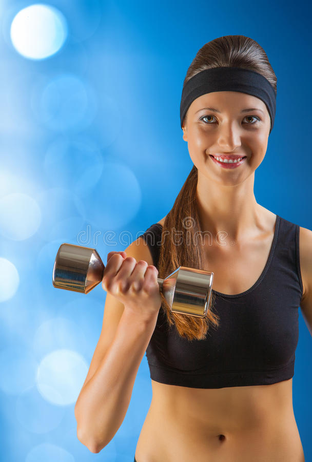Download A Beautyful Sporty Girl With Dumbbell Stock Image - Image: 27810831