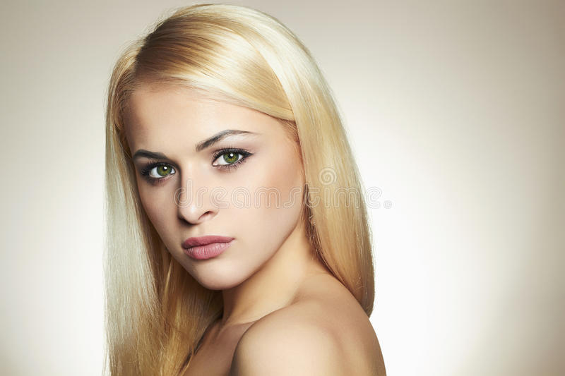 Beautyful Young blond woman. Young blond woman.Beautiful Girl with green eyes.Fashion portrait stock images