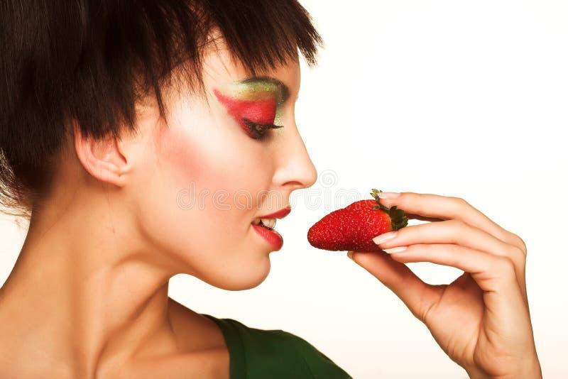 Beautyfull girl with strawberry. Beautyfull smiling girl with strawberry isolated on white royalty free stock photos