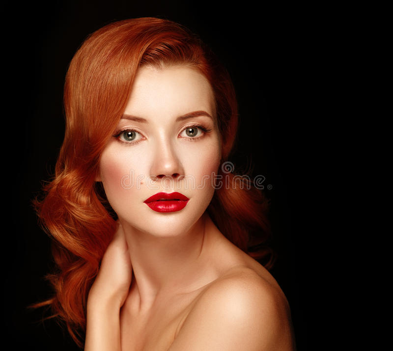 Beauutiful young woman with red hair. Beauutiful young woman with red hair royalty free stock images