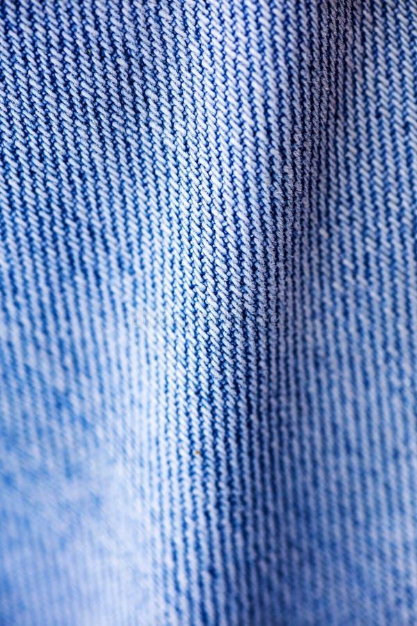 Beaux-arts extr?mes de fond de fibres d'habillement de blues-jean macro dans les produits de haute qualit? 50,6 Megapixels d'impr photographie stock libre de droits