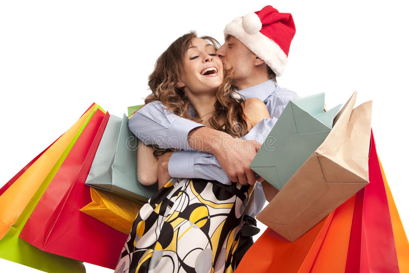 Beaux couples effectuant des achats de Noël images libres de droits