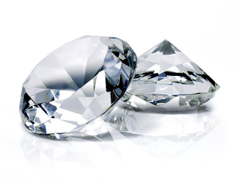 Beaux diamants brillants, sur le fond blanc images libres de droits