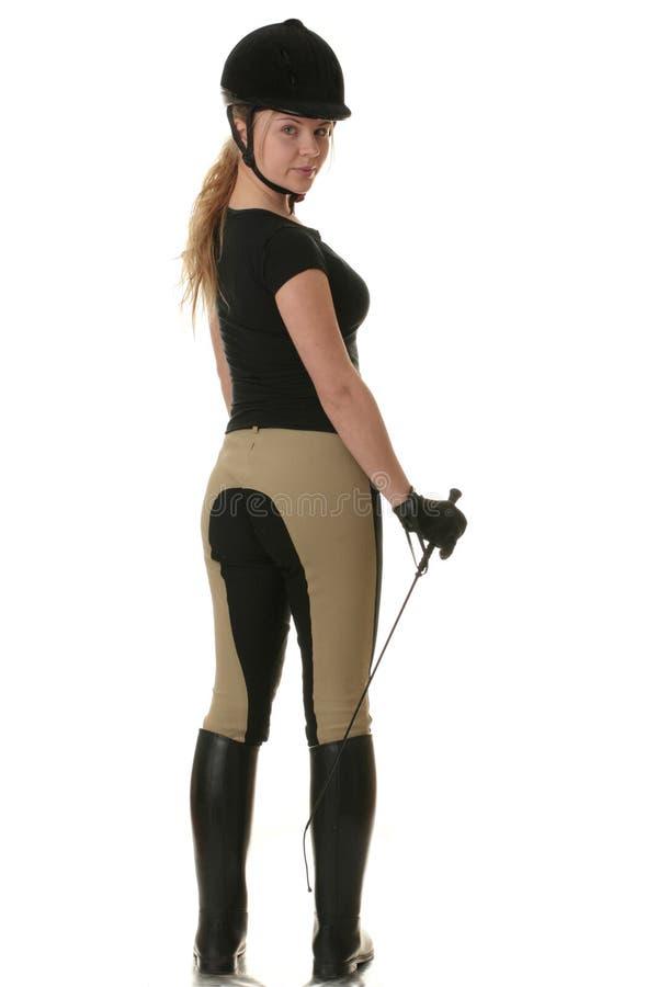 beaux jeunes blonds de femme de jockey image libre de droits