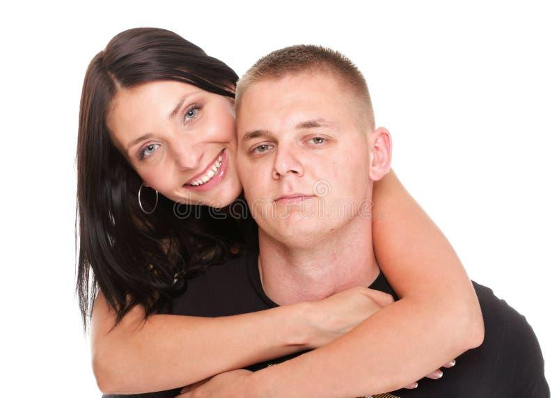 Beaux jeunes couples heureux affectueux d'isolement photo libre de droits