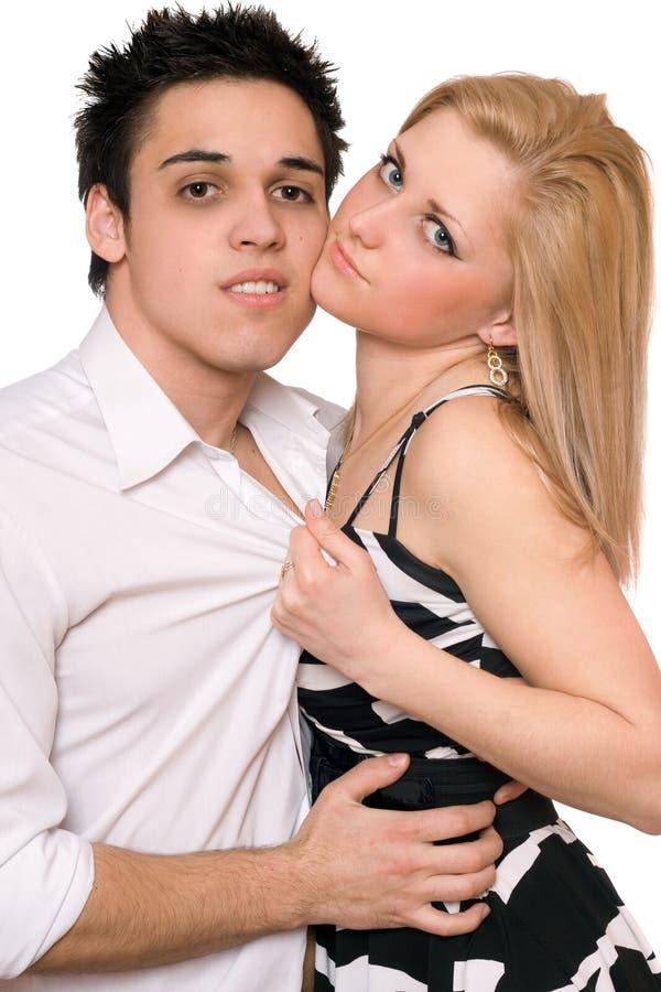 Beaux jeunes couples passionnés. D'isolement photos stock