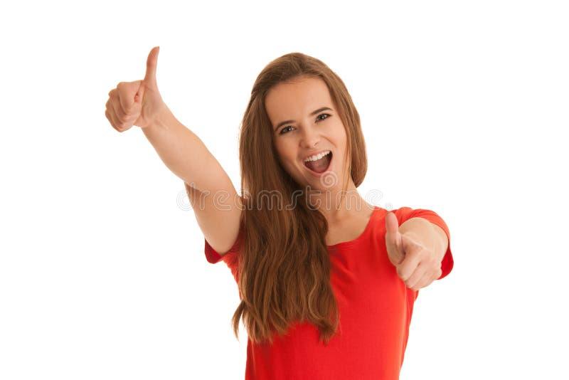 Beaux jeunes succes caucasiens heureux de geste de femme avec le showin photographie stock