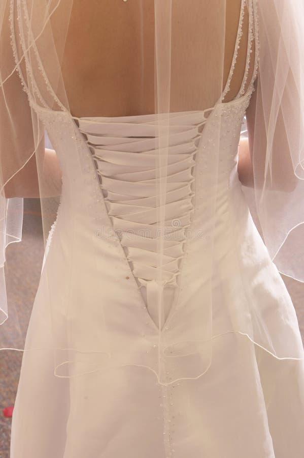 Beaux lacets de robe de mariage photographie stock