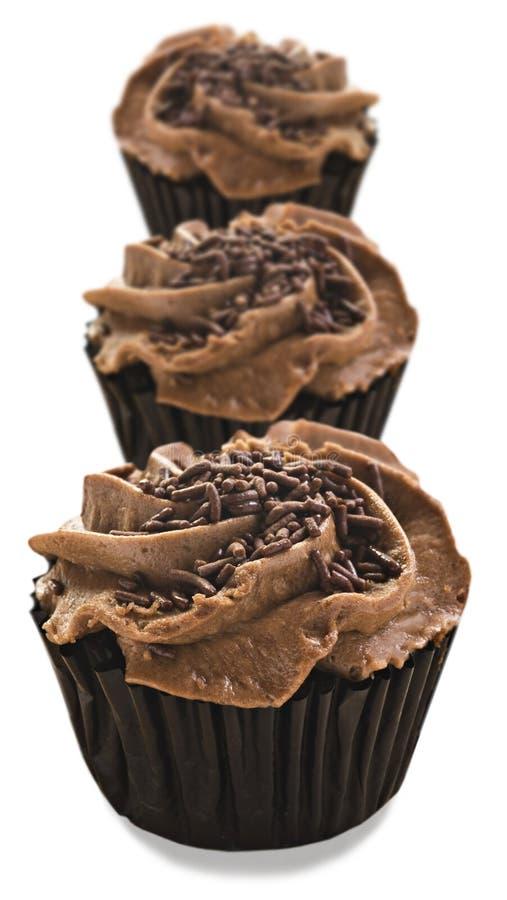 Beaux petits gâteaux frais de chocolat - profondeur du champ très photos stock