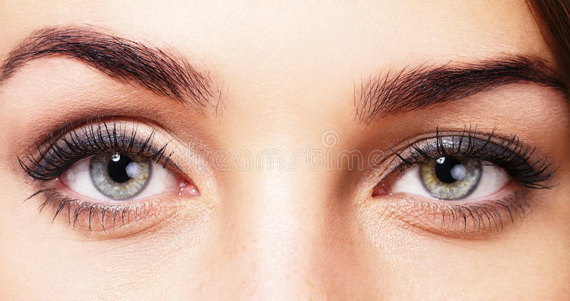 Beaux yeux de womans photos stock