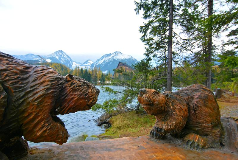 Beavers in High Tatras. Landscape view with wooden beavers at štrbské pleso, High Tatras, Slovakia royalty free stock photography
