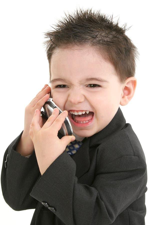 Bebé adorável no terno no telemóvel fotografia de stock