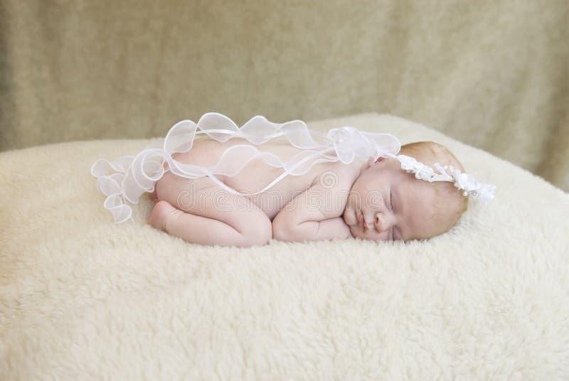 Bebé angélico fotografia de stock