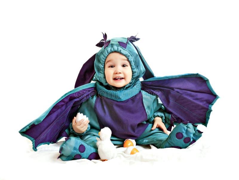 Bebé asiático em um vestido extravagante do dragão fotografia de stock