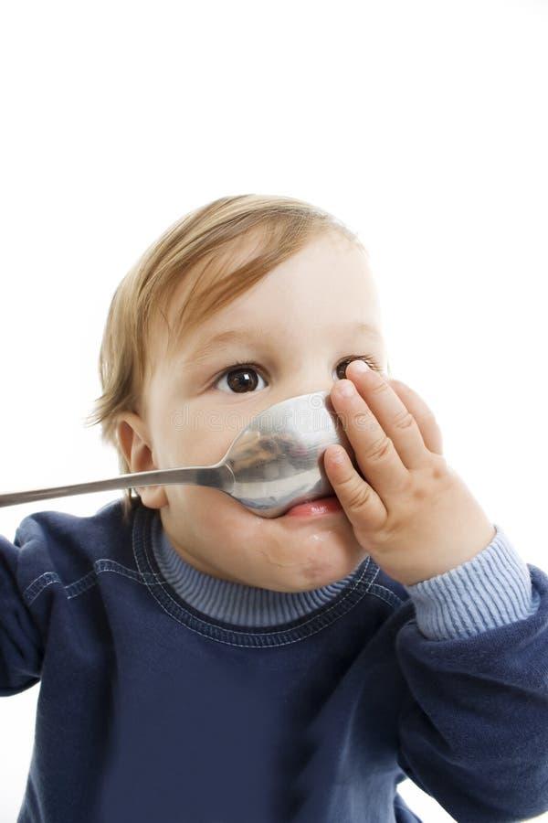 Bebé com colher grande fotos de stock royalty free