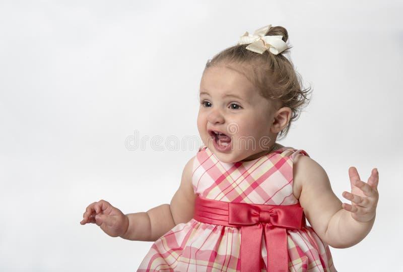Bebé com expressão engraçada fotografia de stock